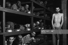 Survivors at Buchenwald Concentration Camp remain in their barracks after liberation by Allies on April 16, 1945. Elie Wiesel, the Nobel Prize winning author of Night, is on the second bunk from the bottom, seventh from the left. (Photo by ? CORBIS/Corbis via Getty Images)